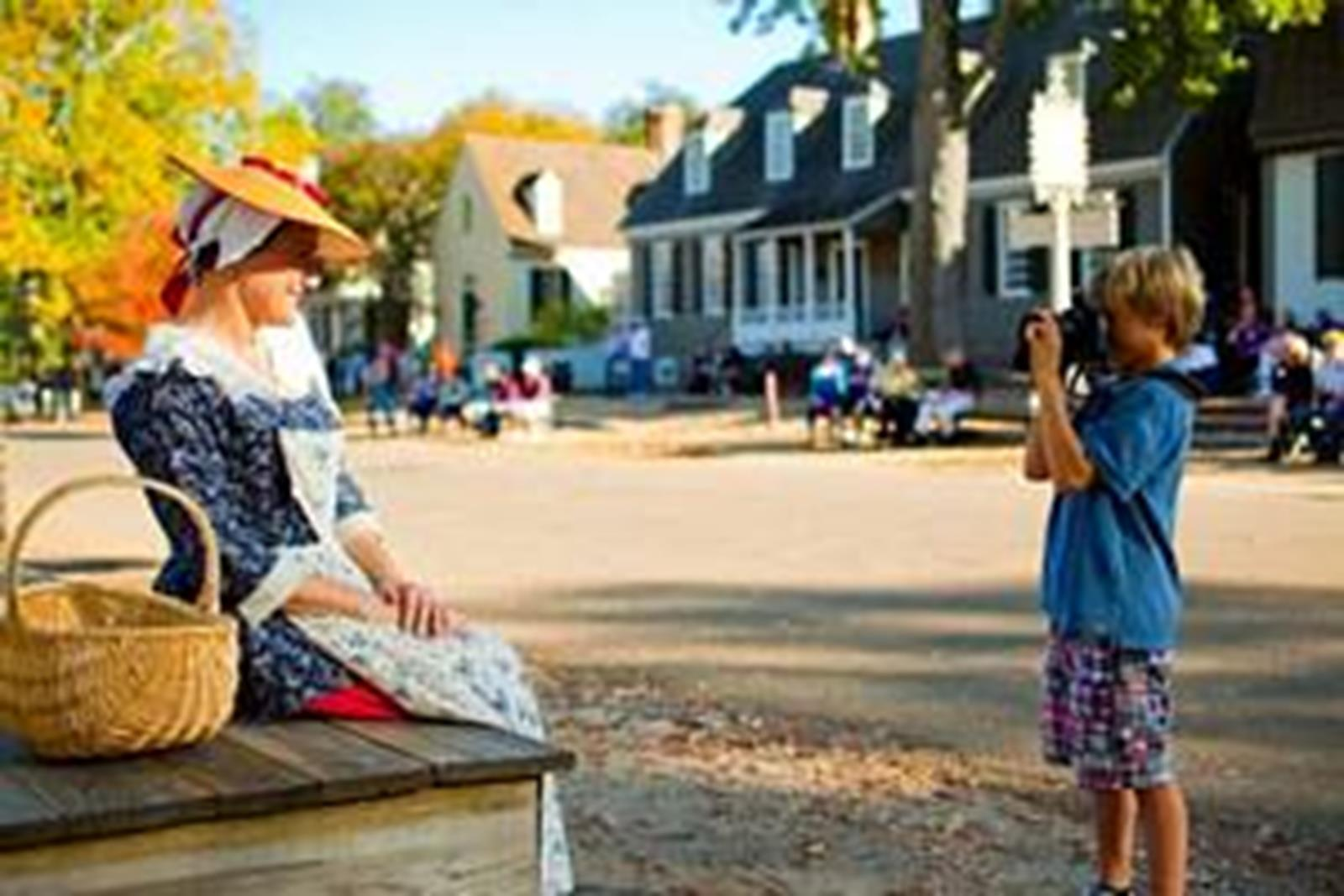 Costumed interpreter poses for tourist at Colonial Williamsburg