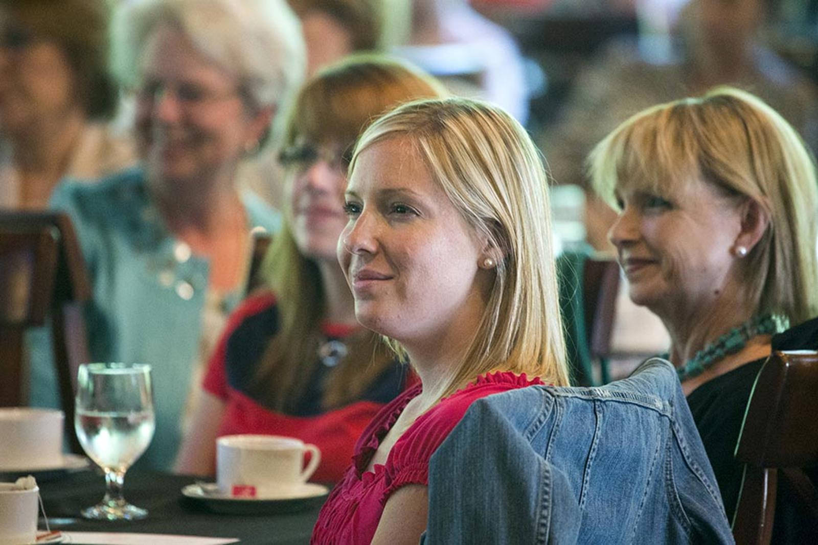 Guests listen to the special speaker during the Ladies Tea and Tour.