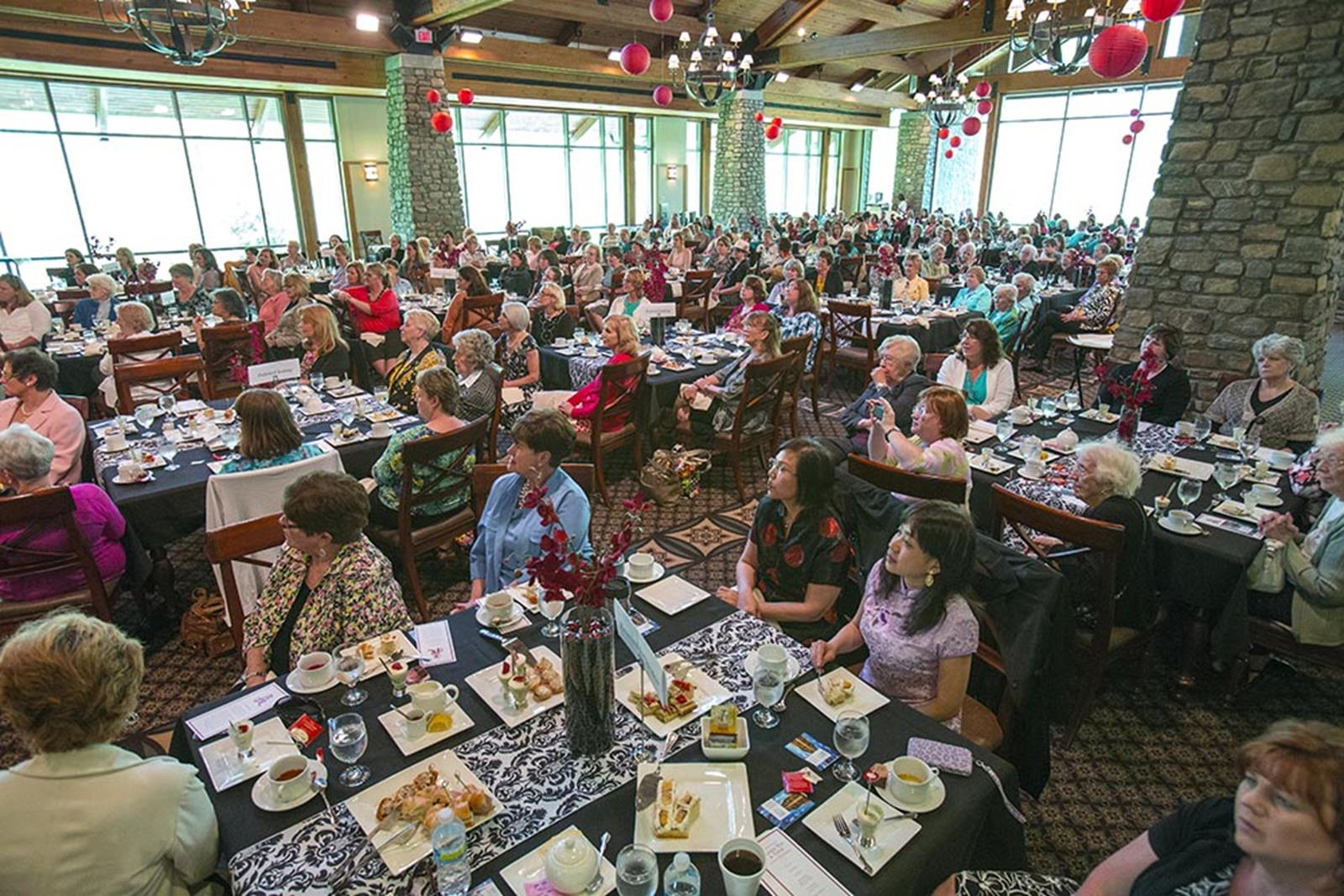 Guests enjoy special music and a popular speaker at the Library's annual Ladies Tea and Tour.