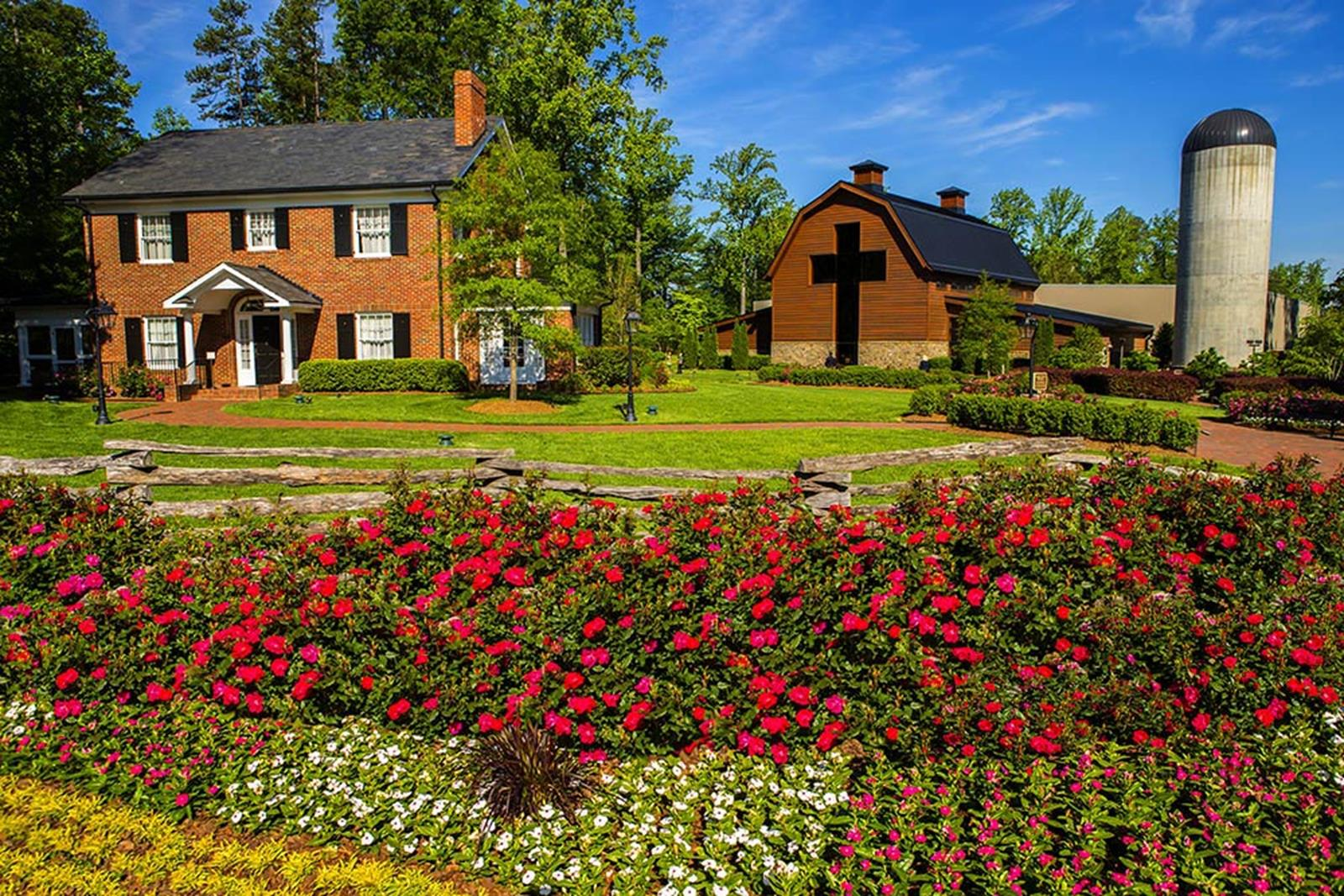 The Library grounds include the Graham family homeplace (left), the main facility (center), and the memorial prayer garden.