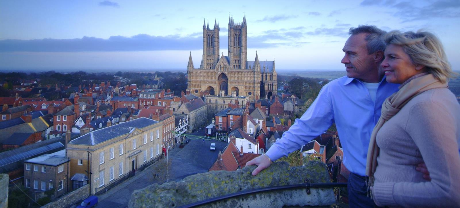 A mature couple enjoying the view from the Observatory Tower at Lincoln Castle.