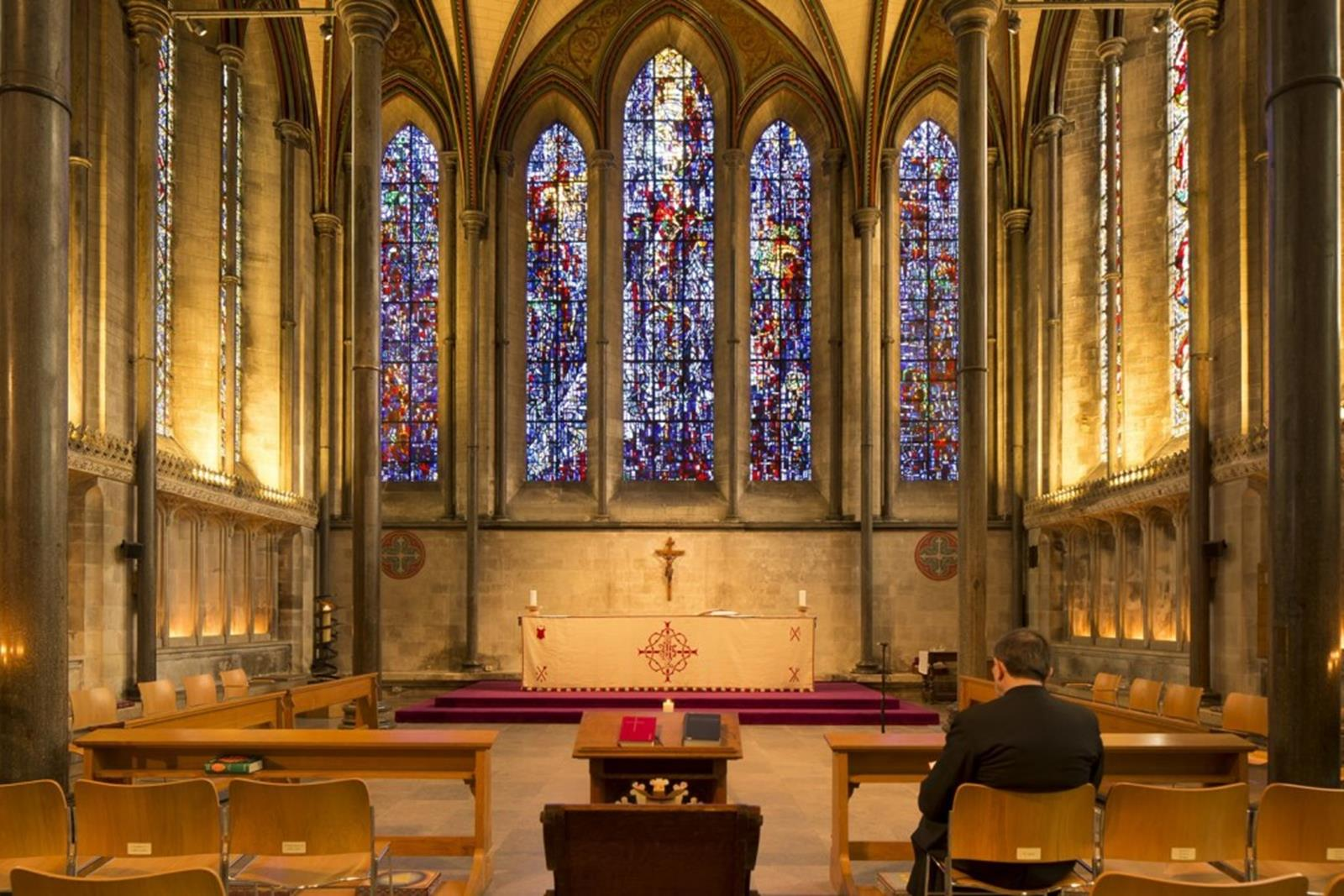 The altar and stained glass windows of Salisbury Cathedral