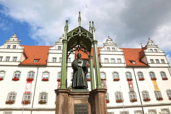 A statue of Martin Luther stands in the market square of Lutherstadt Wittenberg. (JD Andrews earthXplorer Media, Inc.)""
