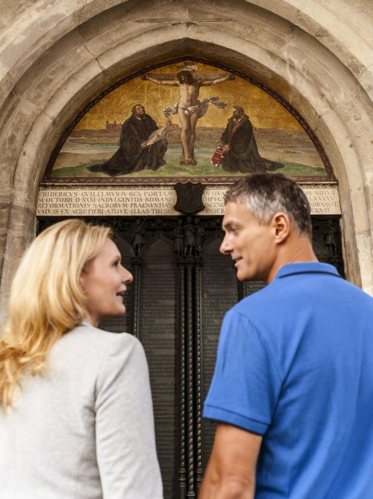 Visitors to Castle Church in Wittenberg view the door where Luther posted his 95 Theses. (IMG Sachsen-Anhalt)